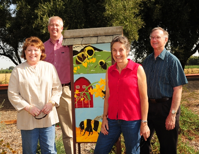A visit to the Haagen-Dazs Honey Bee Haven last September: state regent Debbie Jamison, Fresno beekeeper Brian Liggett; Lynn Kimsey, director of the Bohart Museum of Entomlogy and UC Davis entomology professor; and Extension apiculturist Eric Mussen. (Photo by Kathy Keatley Garvey)