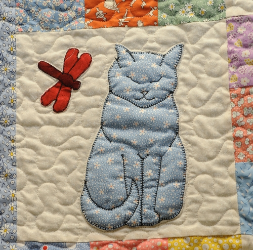 A DRAGONFLY meets a cat in this quilt made by Helen McNaughton of Dixon. It's on display at the May 7-10 Dixon May Fair. (Photo by Kathy Keatley Garvey)