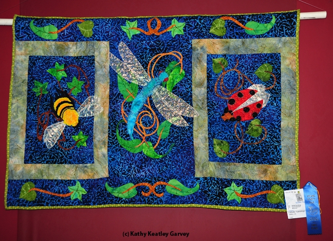 Close-up of blue-ribbon quilt by LaQuita Tummings of Vallejo. It features a bee, dragonfly and ladybug. (Photo by Kathy Keatley Garvey)