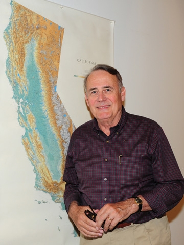 James R. Carey in front of a California map. (Photo by Kathy Keatley Garvey)