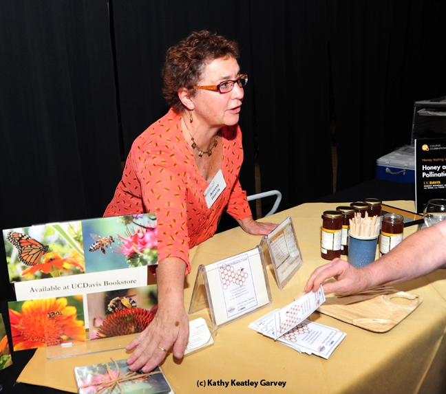 Amina Harris, executive director of the UC Davis Honey and Pollination Center, displayed honey and note cards at the UC Davis College of Agricultural and Environmental Sciences' 25th annual College Celebration. The photos on the note cards were donated by Kathy Keatley Garvey.