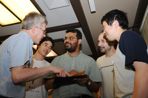 Members of the Walter Leal lab congratulate Zain Syed on his award. From left are Walter Leal, professor of entomology; Zhao Liu, graduate student; Zain Syed; Julien Pelletier, postdoctoral scholar; and Wei Xu, ag chemistry graduate student. (Photo by Kathy Keatley Garvey)