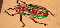 A jeweled beetle, part of the arts and crafts activity. (Photo by Kathy Keatley Garvey) for Bug Squad Blog