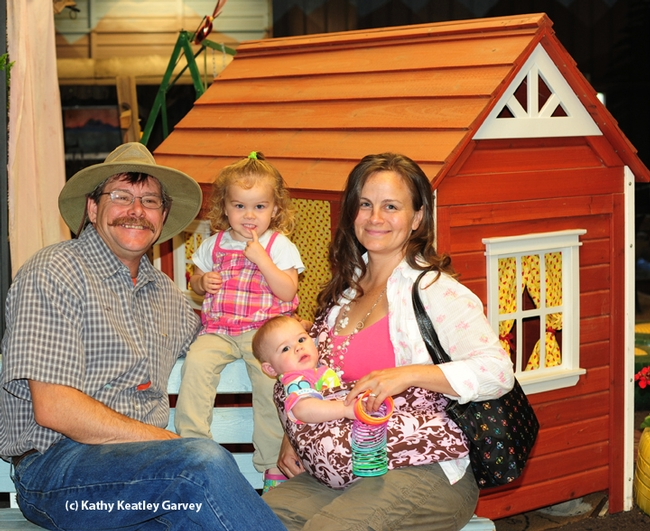 The Fishbacks at the 2013 Dixon May Fair where they had just dropped off a bee observation hive: Brian, daughter Emily, now 3; daughter Jane, now 18 months, and wife Darla. (Photo by Kathy Keatley Garvey)