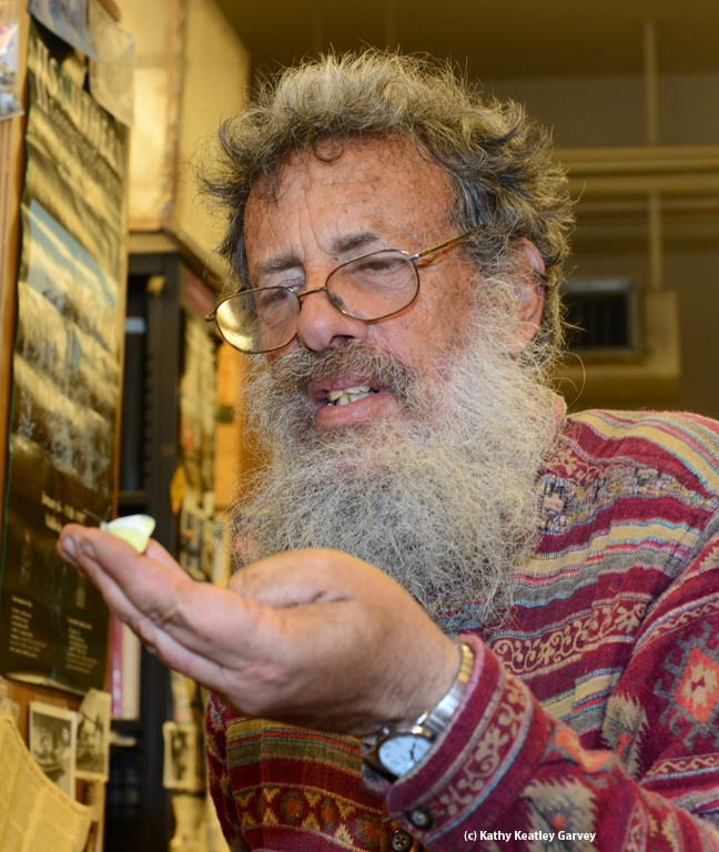 Professor Art Shapiro with his newly netted cabbage white butterfly. (Photo by Kathy Keatley Garvey)