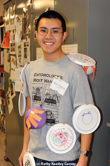 UC Davis entomology major Alex Nguyen, a third-year student, gets
