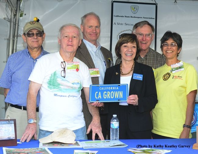 California grown! From left are CSBA treasurer Carlen Jupe, Sacramento, CSBA member Bill Cervenka of Bill Cervenka Apiaries, Half Moon Bay; CSBA president Bill Lewis of Lake View Terrace;  California Secretary of Agriculture Karen Ross; Extension apiculturist Eric Mussen of UC Davis; and SABA member Marti Ikehara of Sacramento. (Photo by Kathy Keatley Garvey)