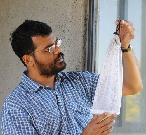 ZAIN SYED, chemical ecologist at UC Davis, holds a bag of 2000 Culex mosquitoes he trapped between Davis and West Sacramento. He is using them for his research. (Photo by Kathy Keatley Garvey)