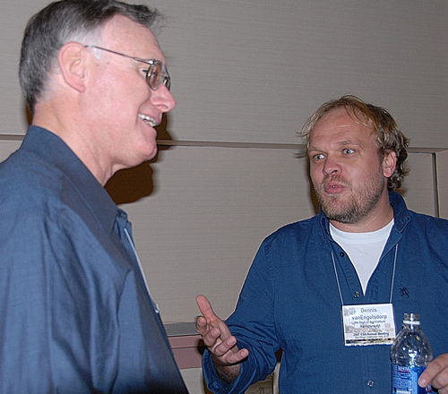 EXTENSION APICULTURIST Eric Mussen (left) of the UC Davis Department of Entomology faculty shares information with Pennsylvania State Uniersity entomologist Dennis van Engelsdorp at the 2007 meeting of the Entomological Society of America. UC Davis and Penn State receive research funds in a project launched by Haagen-Dazs. (Photo by Kathy Keatley Garvey)