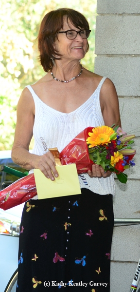 Donna Billick with a bouquet of flowers from UC Davis Arboretum director Kathleen Socolofsky. (Photo by Kathy Keatley Garvey)