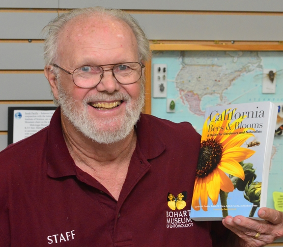Native pollinator specialist Robbin Thorp with a copy of the book. (Photo by Kathy Keatley Garvey)