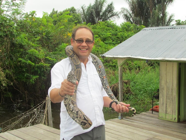 Medical entomologist Anthony Cornel with a snake in Brazil.
