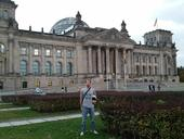 Matan Shelomi, wearing a UC Davis entomology shirt, stands in front of the Reichstag in Berlin.