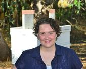 Extension apiculturist Elina Niño in front of hives at the Harry H. Laidlaw Jr. Honey Bee Research Facility. (Photo by Kathy Keatley Garvey)