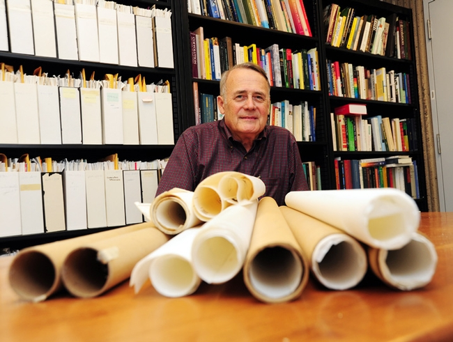 UC Davis Distinguished Professor James R. Carey with some of the maps he used in his research. (Photo by Kathy Keatley Garvey)