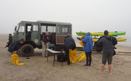 James R.Carey (far left) preparing for kayaking with fur seals at Walvis Bay, Namibia, Africa (Photo by Patty Carey)