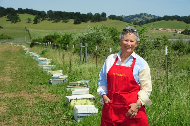Ann Sievers stands by her bees, a new addition to  IL Fiorello. This week is National Pollinator Week. (Photo by Kathy Keatley Garvey)