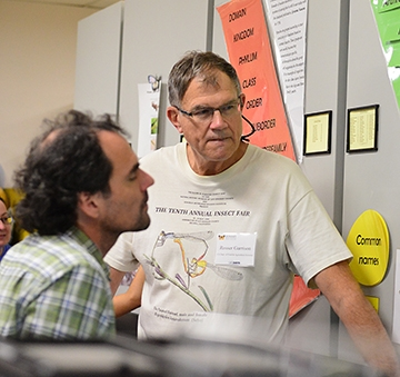 Rosser Garrison (right) talks with Andrew Rehn of Sacramento, who received his doctor from UC Davis in 2000 (major professor Lynn Kimsey). Rehn is now a stream ecologist with the California Department of Fish and Wildlife. (Photo by Kathy Keatley Garvey)