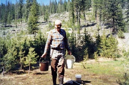 AT WORK--William C. Reeves collecting mosquitoes in Baker County, Ore., in 1993. (Photo by Bruce Eldridge)