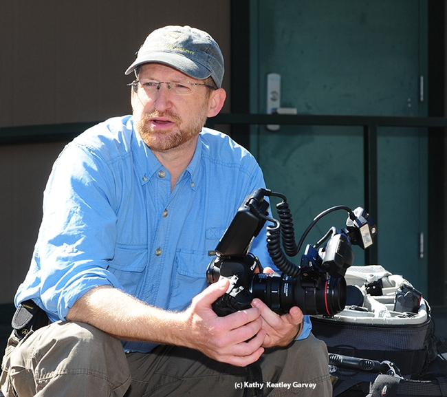 John Abbott discusses camera equipment for macro photography at BugShot Hastings. (Photo by Kathy Keatley Garvey)