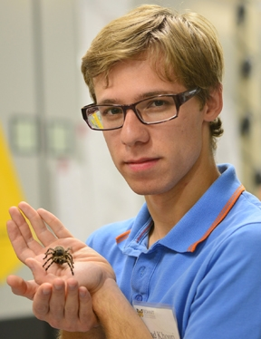 Ziad Khouri, graduate student in entomology at UC Davis, holds a rose-haired tarantula. (Photo by Kathy Keatley Garvey)