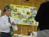 Nathaniel Haddon, 9, of the Vaca Valley 4-H Club, Vacaville, discusses bees at the Solano County 4-H Presentation Day. (Photo by Kathy Keatley Garvey)