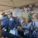 California State Beekeepers' Association secretary-treasurer Carlin Jupe (left) and member Bill Cervenka get ready to greet the crowds at Cal Ag Day. (Photo by Kathy Keatley Garvey)