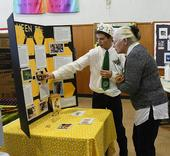 Evaluator Linda Layton of Sherwood Forest 4-H Club, Vallejo, talks to Ryan Anenson about his honey bee project at the Solano County 4-H Project Skills Day. (Photo by Kathy Keatley Garvey)