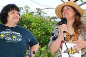 Tora Rocha (left), founder of the Pollinator Posse of Oakland (soon to be statewide), and Mia Monroe, coordinator of the Xerces Society's Western Monarch Thanksgiving Count, address the crowd. (Photo by Kathy Keatley Garvey)