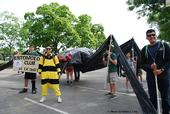 UC Davis Entomology Club members with the black widow spider float are (from left) Darian Dungey, James Fong, Chloe Shott (partially shown), Ben Maples (partially shown) James Heydon,   Maia Lundy, Diego Rivera. Lundy is the president of the club. (Photo by Melissa Cruz)