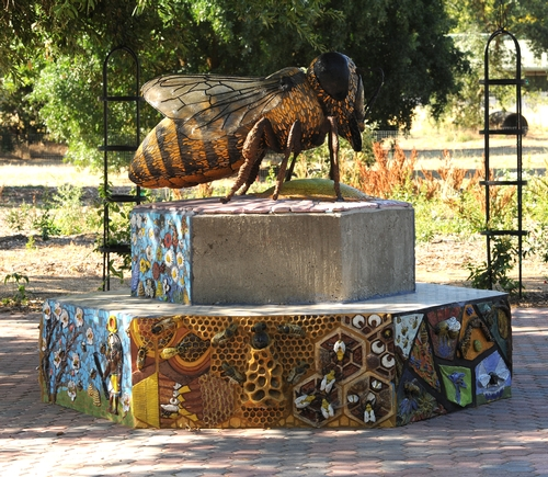THIS HUGE BEE sculpture at the Haagen-Dazs Honey Bee Haven is the work of nationally renowned artist Donna Billick, based in Davis. Those who donate $1000 to the honey bee haven will have their names placed on ceramic art tile below the sculpture. The deadline to pledge is July 20. (Photo by Kathy Keatley Garvey)