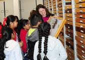 Tabatha Yang, education and outreach coordinator at the Bohart Museum of Entomology, shows butterfly specimens to a group of students. She received a Citation for Excellence from the UC Davis Staff Assembly for outstanding contributions. (Photos by Kathy Keatley Garvey)