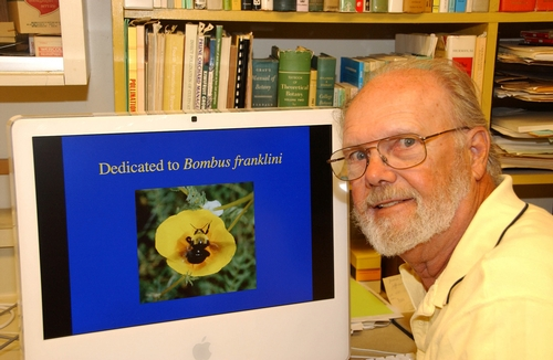 NOTED bumble bee expert Robbin Thorp, shown here in his office at the Harry H. Laidlaw Jr. Honey Bee Research Facility at UC Davis, is on a mission to protect Franklin's bumble bee (Bombus franklini). His  computer screen shows one of his images of the imperiled bumble bee. (Photo by Kathy Keatley Garvey)