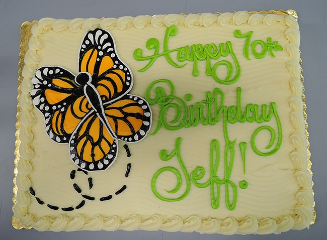 Entomologist Jeff Smith's 70th birthday cake featured a monarch butterfly motif. A 30-year volunteer at the Bohart Museum of Entomology, he curates the butterfly and moth collection.  (Photo by Kathy Keatley Garvey)