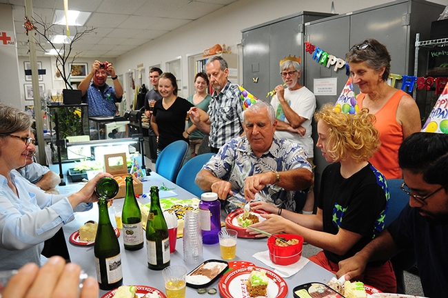 Entomologist Jeff Smith (center) is surrounded by friends and colleagues at his surprise birthday party. They enjoyed carrot cake, ice cream and sparkling apple juice. (Photo by Kathy Keatley Garvey)