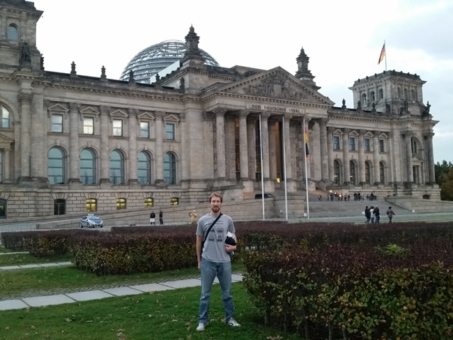 World traveler and scientist Matan Shelomi, wearing a Bohart Museum of Entomology shirt at  at the Reichstag in Berlin.