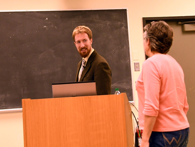 Matan Shelomi heads to the podium to deliver his seminar on his stick insect research. At right is major professor Lynn Kimsey, director of the Bohart Museum of Entomology. (Photo by Kathy Keatley Garvey)