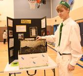 Ian Weber of the Vaca Valley 4-H Club, a second-year beekeeper, displays his project at the Solano County 4-H Project Skills Day. He won a showmanship award. (Photo by Kathy Keatley Garvey)