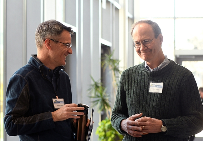 Professor Neal Williams (left) of the UC Davis Department of Entomology and Nematology, shares a laugh with keynote speaker Tom Seeley of Cornell. (Photo by Kathy Keatley Garvey)