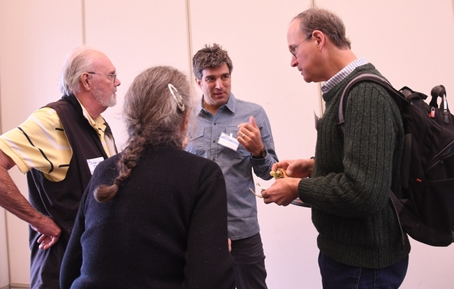 The panel of judges conferring. In the foreground is timer Mea McNeil. In back (from left) are judges Robbin Thorp and Santiago Ramirez of UC Davis, and Tom Seeley of Cornell. (Photo by Kathy Keatley Garvey)