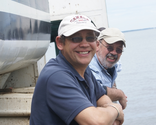 MOSQUITO RESEARCHERS Anton Cornel (front) and Gregory Lanzaro aboard a ferry on Lake Victoria, Kenya, in June of this year. They do research in Africa on malaria mosquitoes. (Photo by Stephen Mulligan)