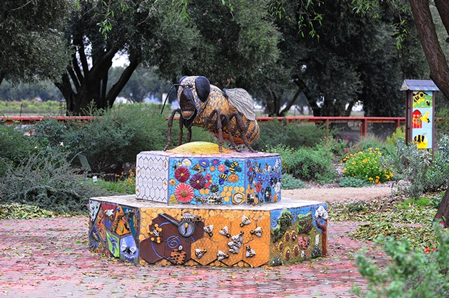 This is Miss Bee Haven, a mosaic-ceramic sculpture that anchors Haagen-Dazs Honey Bee Haven. It is the work of self-described