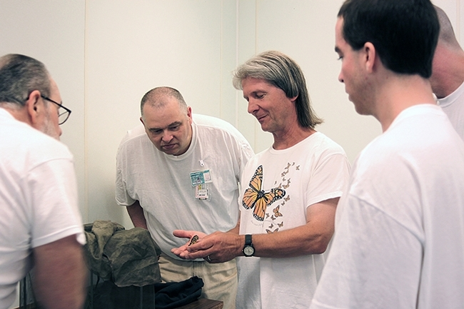 WSU entomologist David James, wearing a monarch t-shirt, with citizen-scientist inmates at Washington State Penitentiary, Walla Walla.