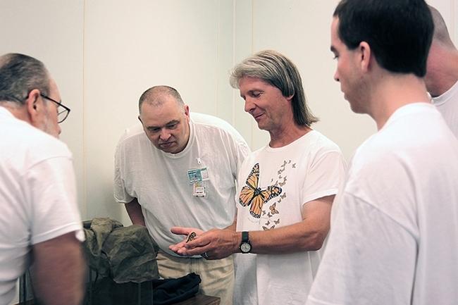 WSU entomologist David James, wearing a monarch t-shirt, with citizen-scientist inmates at Washington State Penitentiary, Walla Walla.