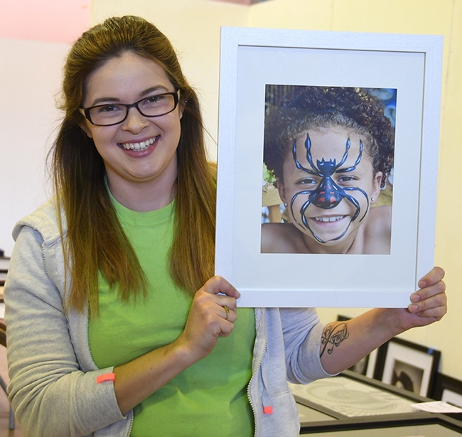 Julie Payne, resource leader for Sherwood Forest 4-H Club, Vallejo, holds an image of