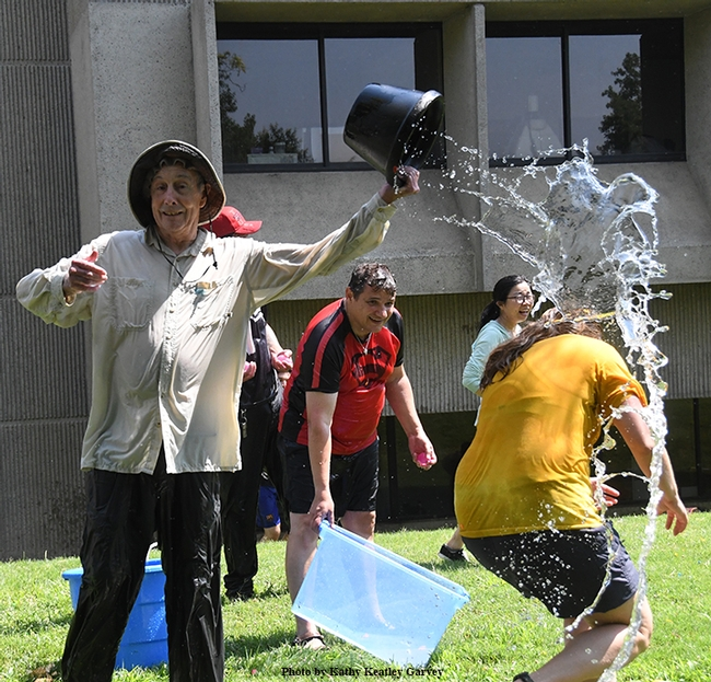Proving himself an elite water warrior, Bruce Hammock nonchalantly empties a bucket of water on his doctoral student, Cindy McReynolds.