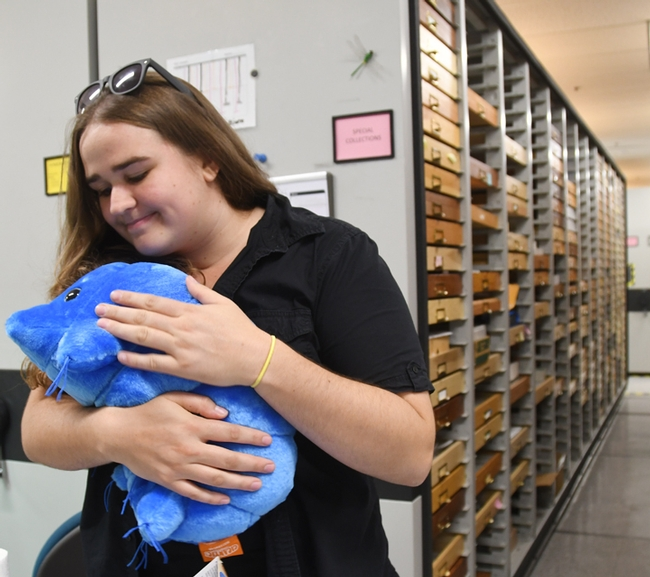 What's not to love about a water bear? UC Davis student and Bohart associate Emma Cluff hugs the stuffed toy. (Photo by Kathy Keatley Garvey)