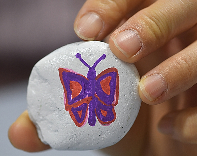 What's a rock without a butterfly on it? (Photo by Kathy Keatley Garvey)
