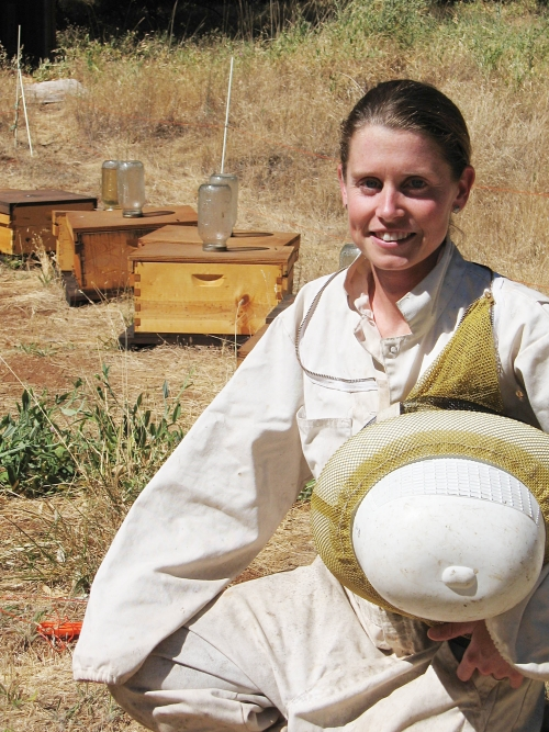 Michelle Flenniken next to Grass Valley hives. (Photo by Kim Fondrk)