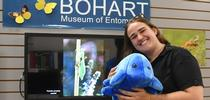 Bohart associate Emma Cluff cuddles a tardigrade, one of the stuffed animals available for sale in the Bohart Museum of Entomology's gift shop. (Photo by Kathy Keatley Garvey) for Bug Squad Blog